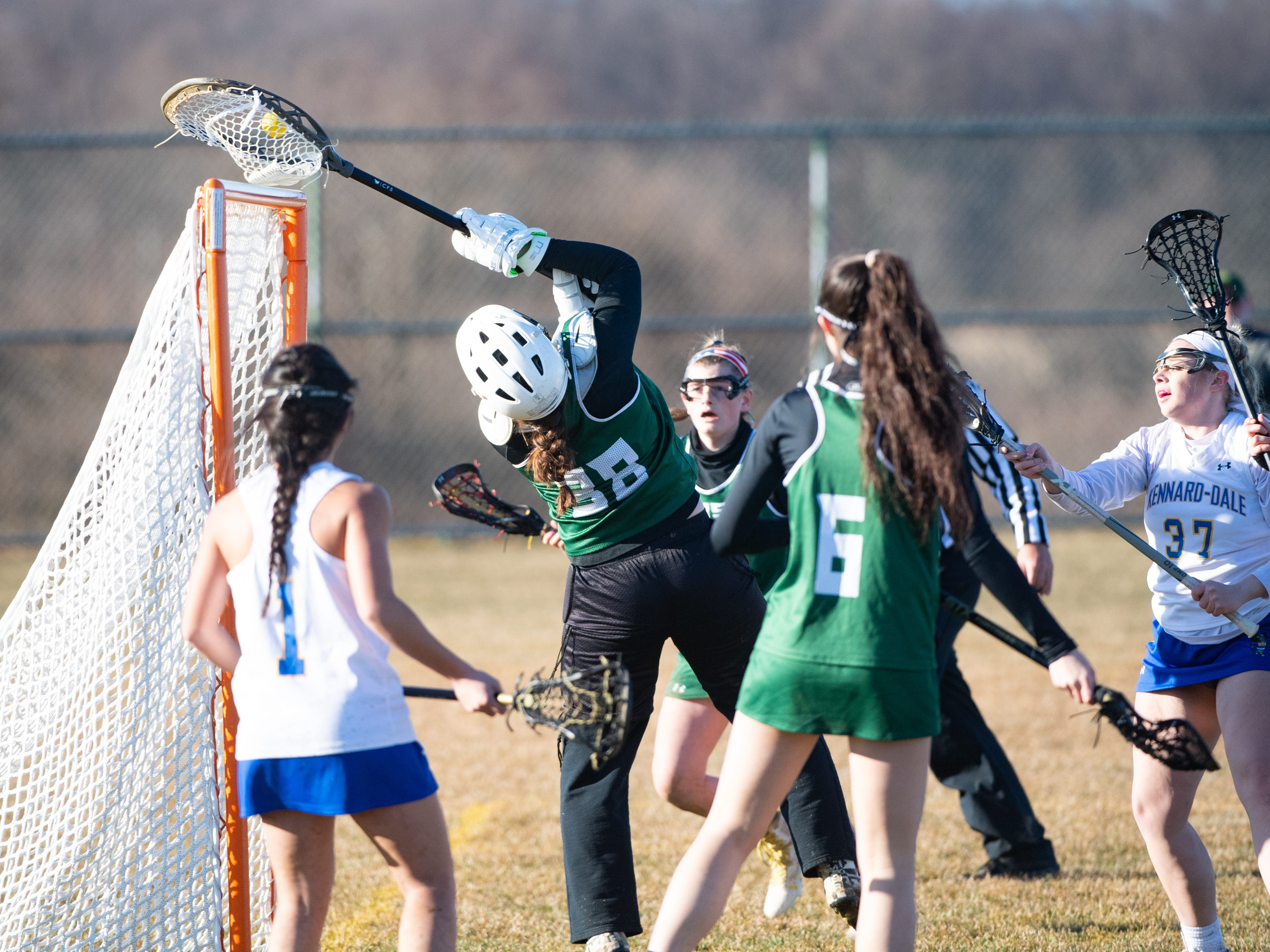 Morghan Kilduff (38) makes an acrobatic save during the girls' lacrosse game between Kennard-Dale and York Catholic, March 26, 2019 at Kennard-Dale High School. The Fighting Irish defeated the Rams 10 to 9.
