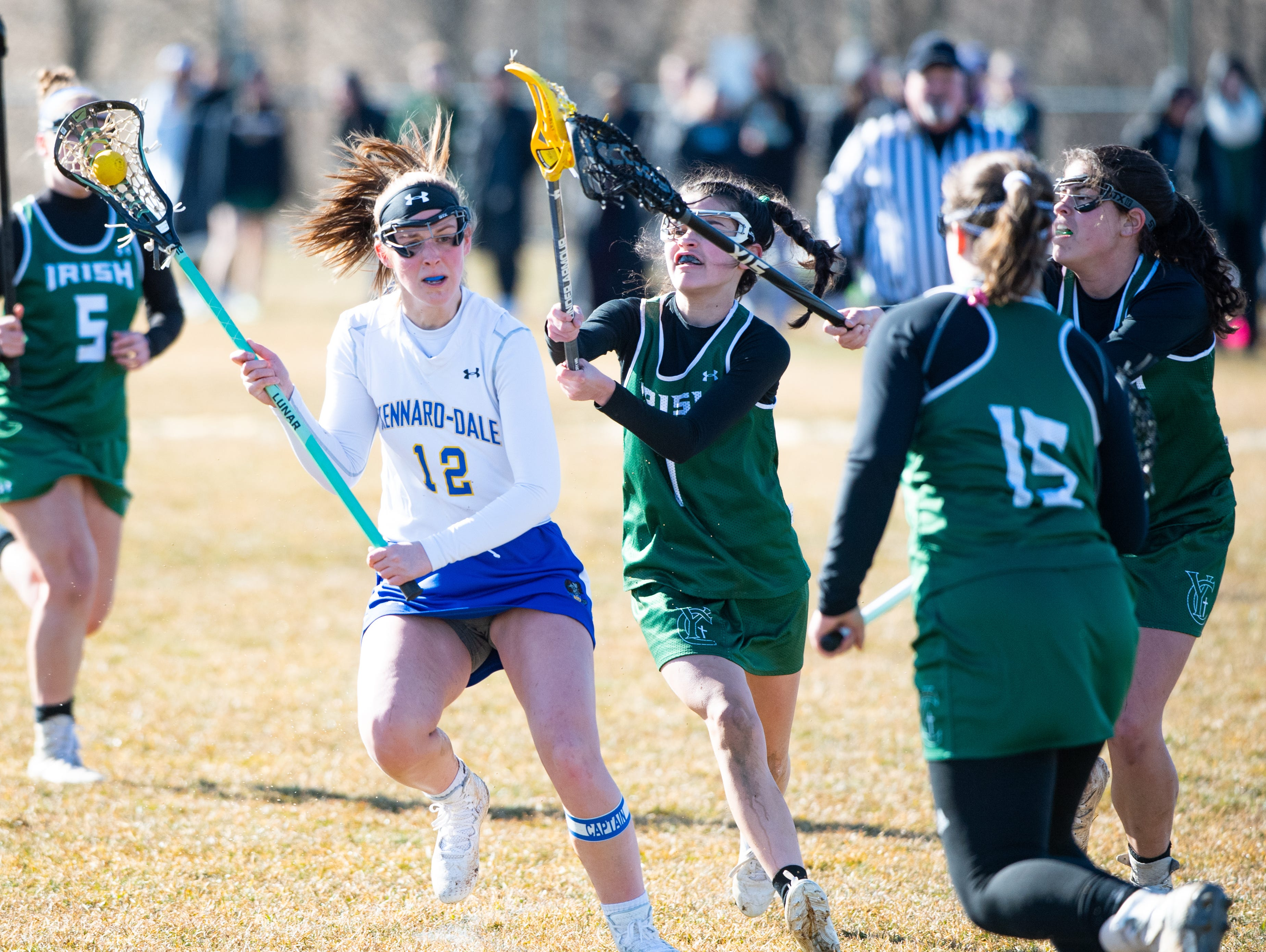 Mackenzie Young (12) tries to get past the defense during the girls' lacrosse game between Kennard-Dale and York Catholic, March 26, 2019 at Kennard-Dale High School. The Fighting Irish defeated the Rams 10 to 9.