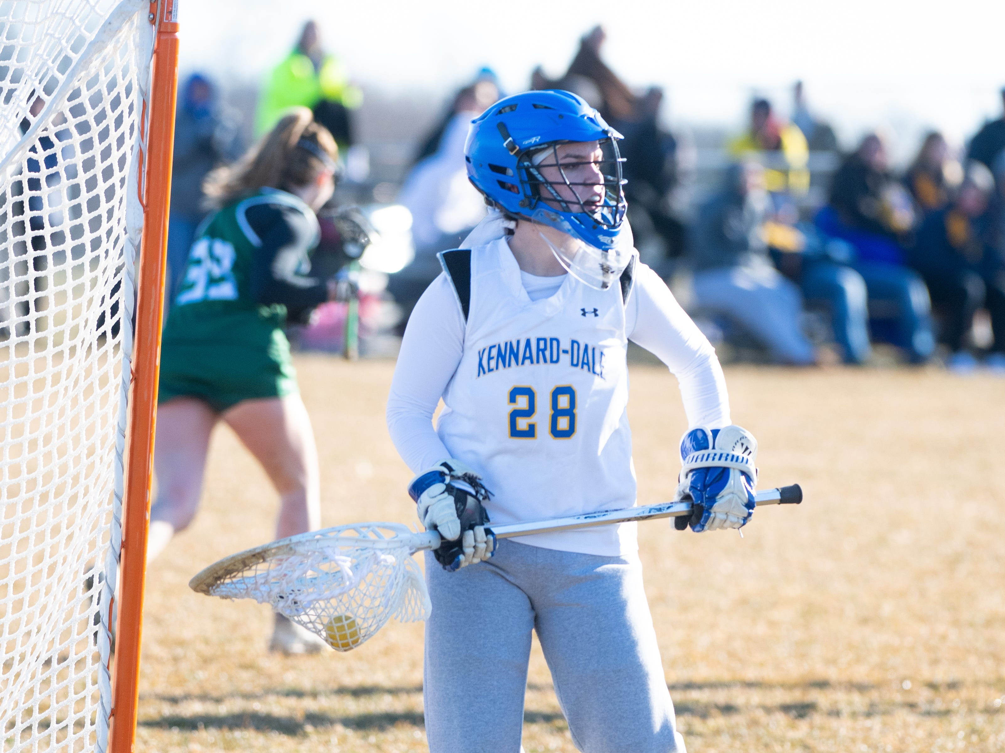 Maria Schneider (28) made the save during the girls' lacrosse game between Kennard-Dale and York Catholic, March 26, 2019 at Kennard-Dale High School. The Fighting Irish defeated the Rams 10 to 9.