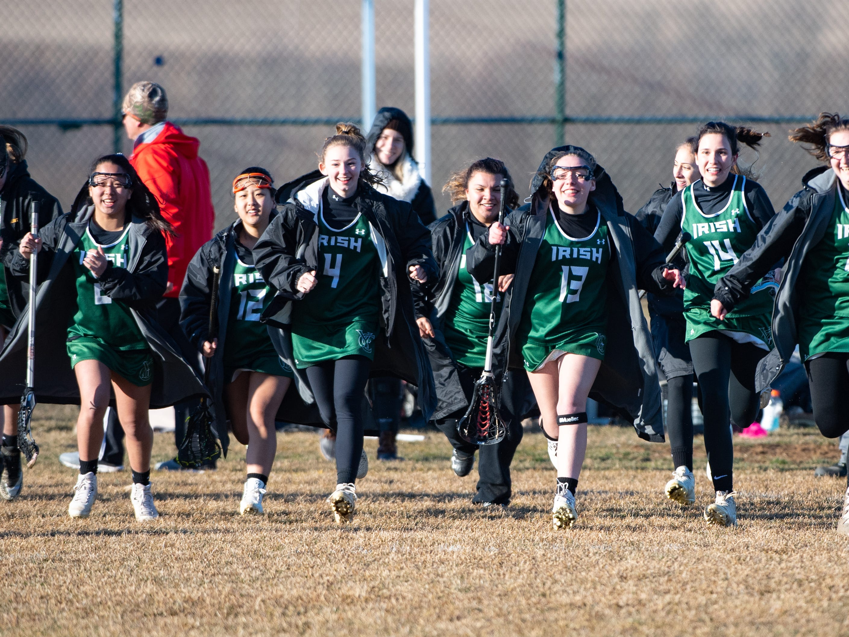 York Catholic rushes the field after defeating Kennard-Dale 10 to 9 in the girls' lacrosse game, March 26, 2019.