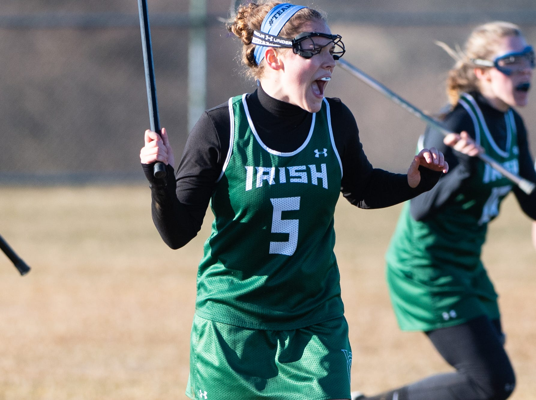 Grace Doyle (5) intimidates the defense during the girls' lacrosse game between Kennard-Dale and York Catholic, March 26, 2019 at Kennard-Dale High School. The Fighting Irish defeated the Rams 10 to 9.