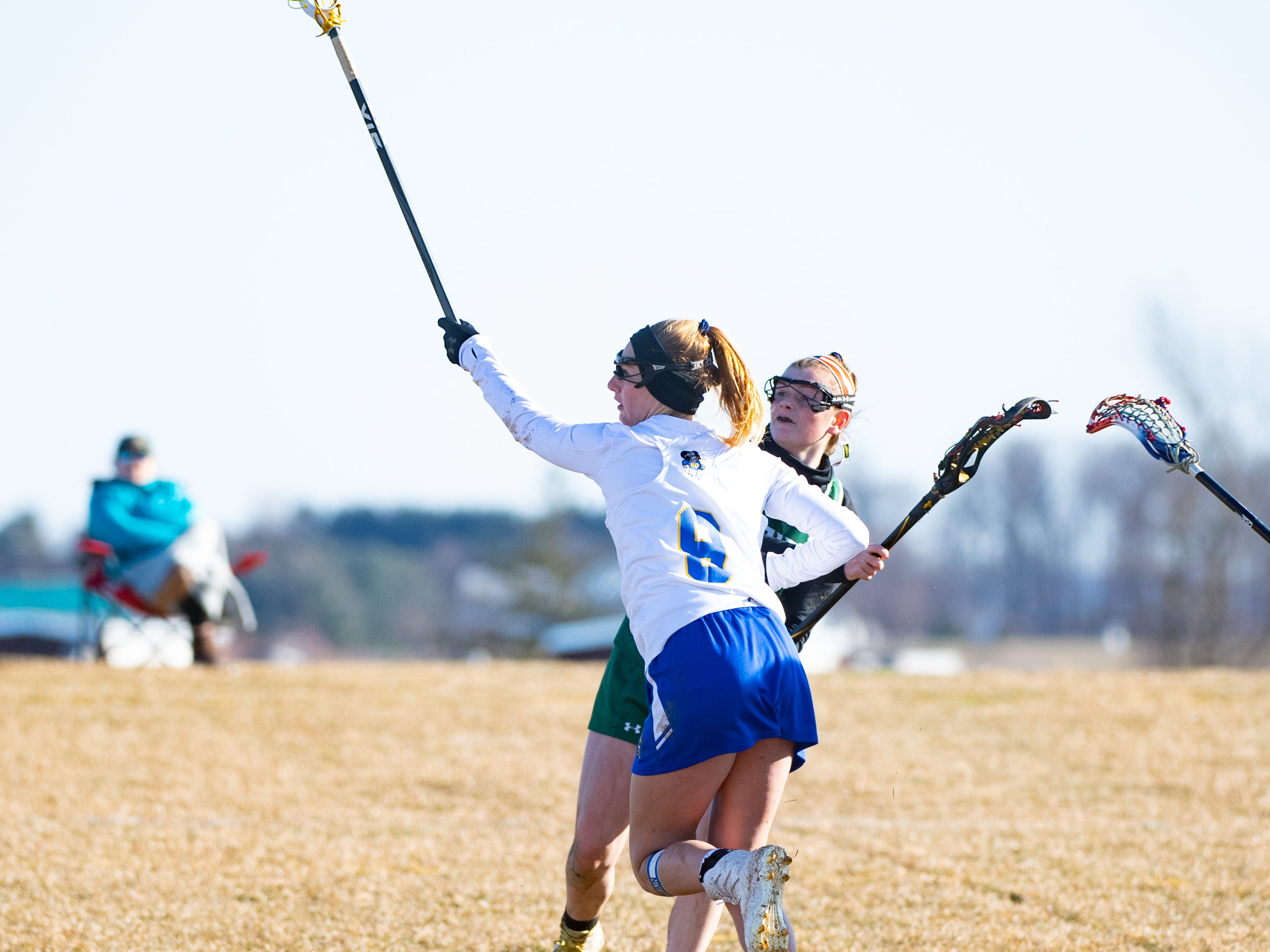 Mikayla Hostler (8) defends the pass during the girls' lacrosse game between Kennard-Dale and York Catholic, March 26, 2019 at Kennard-Dale High School. The Fighting Irish defeated the Rams 10 to 9.