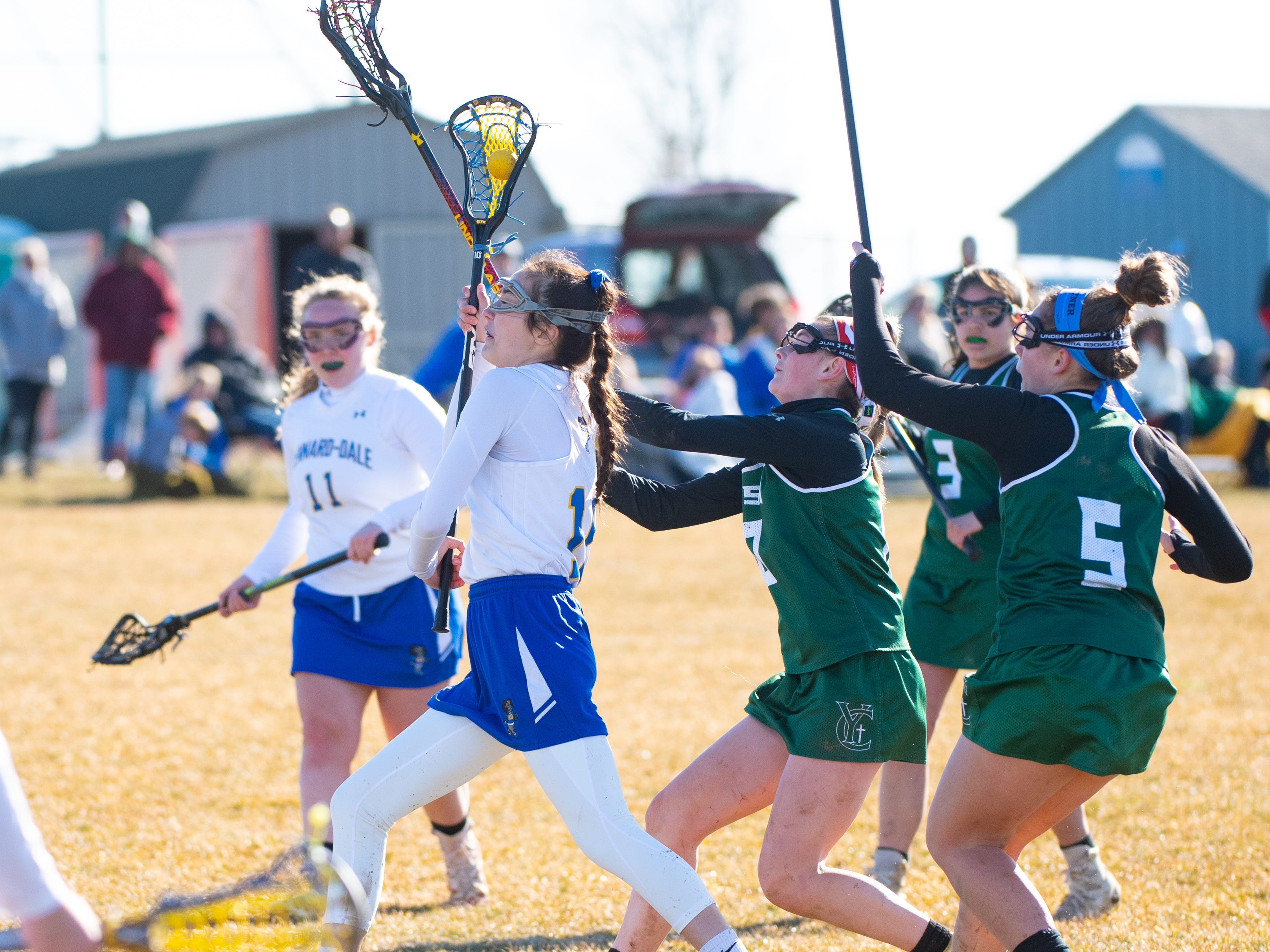 Sydney Mentzer (10) runs towards the net during the girls' lacrosse game between Kennard-Dale and York Catholic, March 26, 2019 at Kennard-Dale High School. The Fighting Irish defeated the Rams 10 to 9.