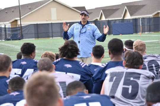 Nevada head coach Jay Norvell addresses his team at the end of Tuesday's practice at Wolf Pack Park.