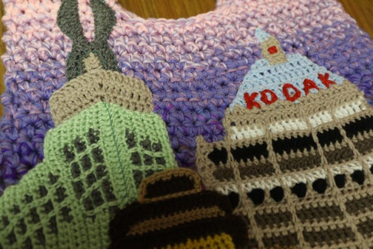 The Times Square Building, First Federal Plaza and Kodak Tower are featured on the back of Ashley Lee Zhong's crocheted 'Dawn in Rochester' coat.