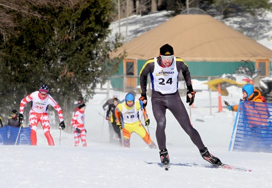 Honeoye Falls-Lima's Teddy Warfle heads for the finish line with Section II and Section VII in close pursuit at the New York State Nordic Skiing Championships.