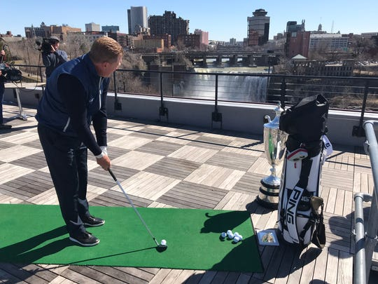 Paul Broadhurst, winner of the 2018 Senior PGA Championship, uses a 'gentle wedge' to drop some shots into the Genessee River off the top of the Genesee Brew House.