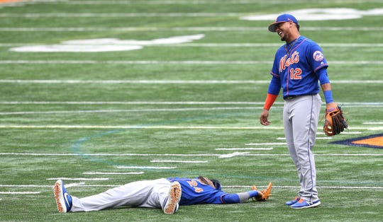 Robinson Cano and Juan Lagares joke around at the Mets' workout at the Carrier Dome at Syracuse University on Tuesday.