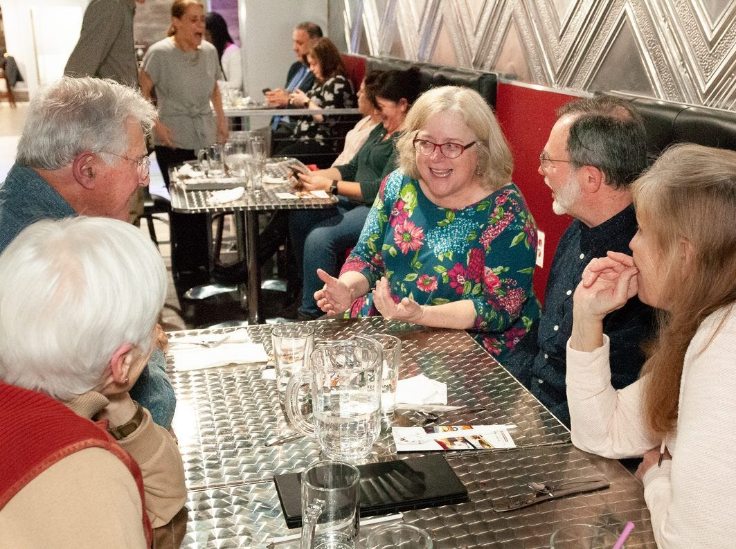 D&C food and drink reporter chats with guests at the ROCFlavors dinner at MamaJuana on March 20, 2019.