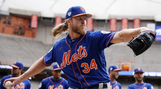 Noah Syndergaard working out at the Mets' practice Tuesday.