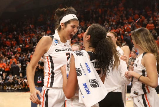 Oregon State's Andrea Aquino (2) and Taya Corosdale celebrate the team's 76-70 victory over Gonzaga in a second-round game of the NCAA women's college basketball tournament in Corvallis, Ore., Monday, March 25, 2019.