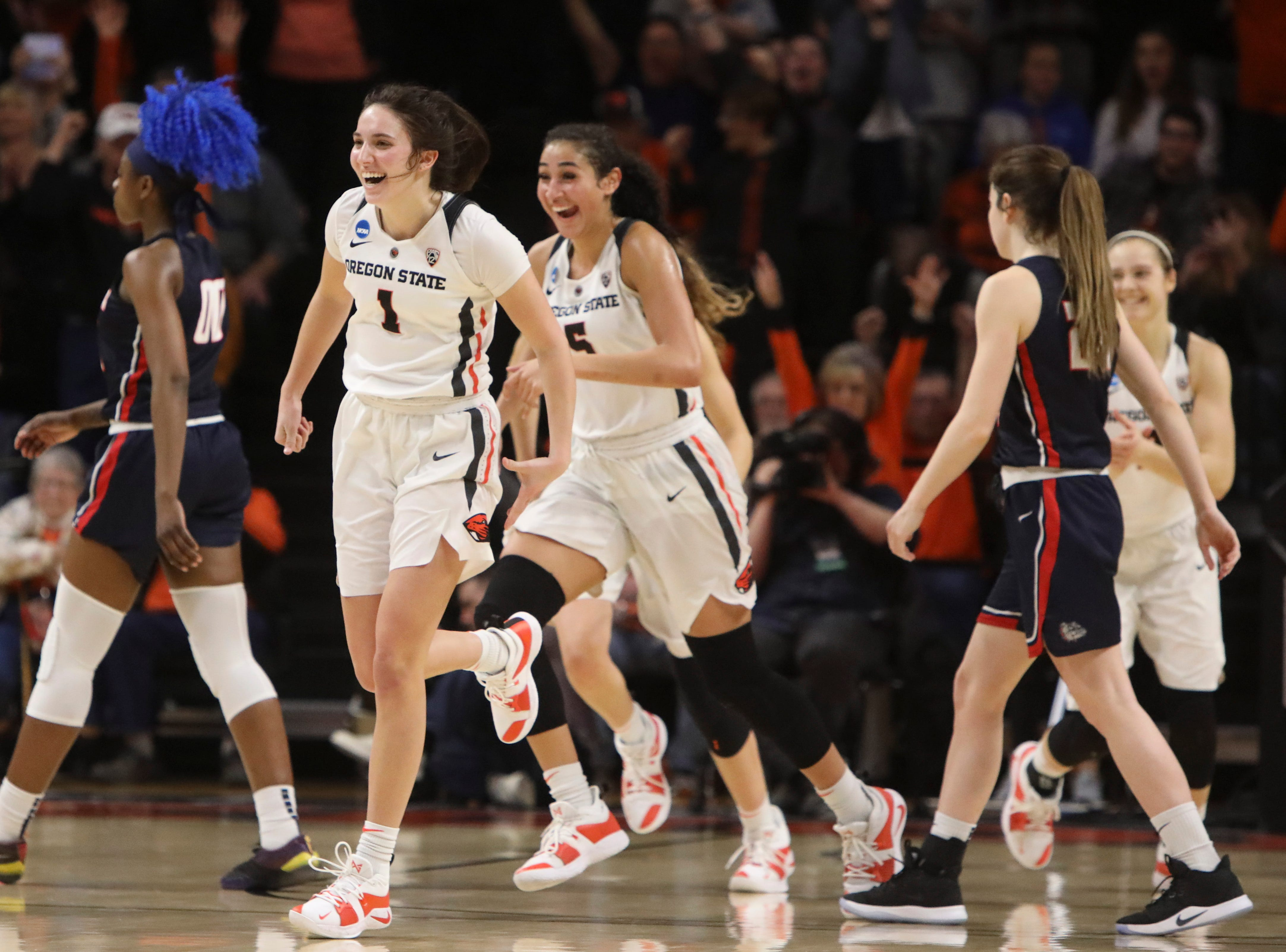 Oregon State's Aleah Goodman (1) and Taya Corosdale (5) run toward their teammates after the team's 76-70 victory over Gonzaga in a second-round game of the NCAA women's college basketball tournament in Corvallis, Ore., Monday, March 25, 2019. (AP Photo/Amanda Loman)