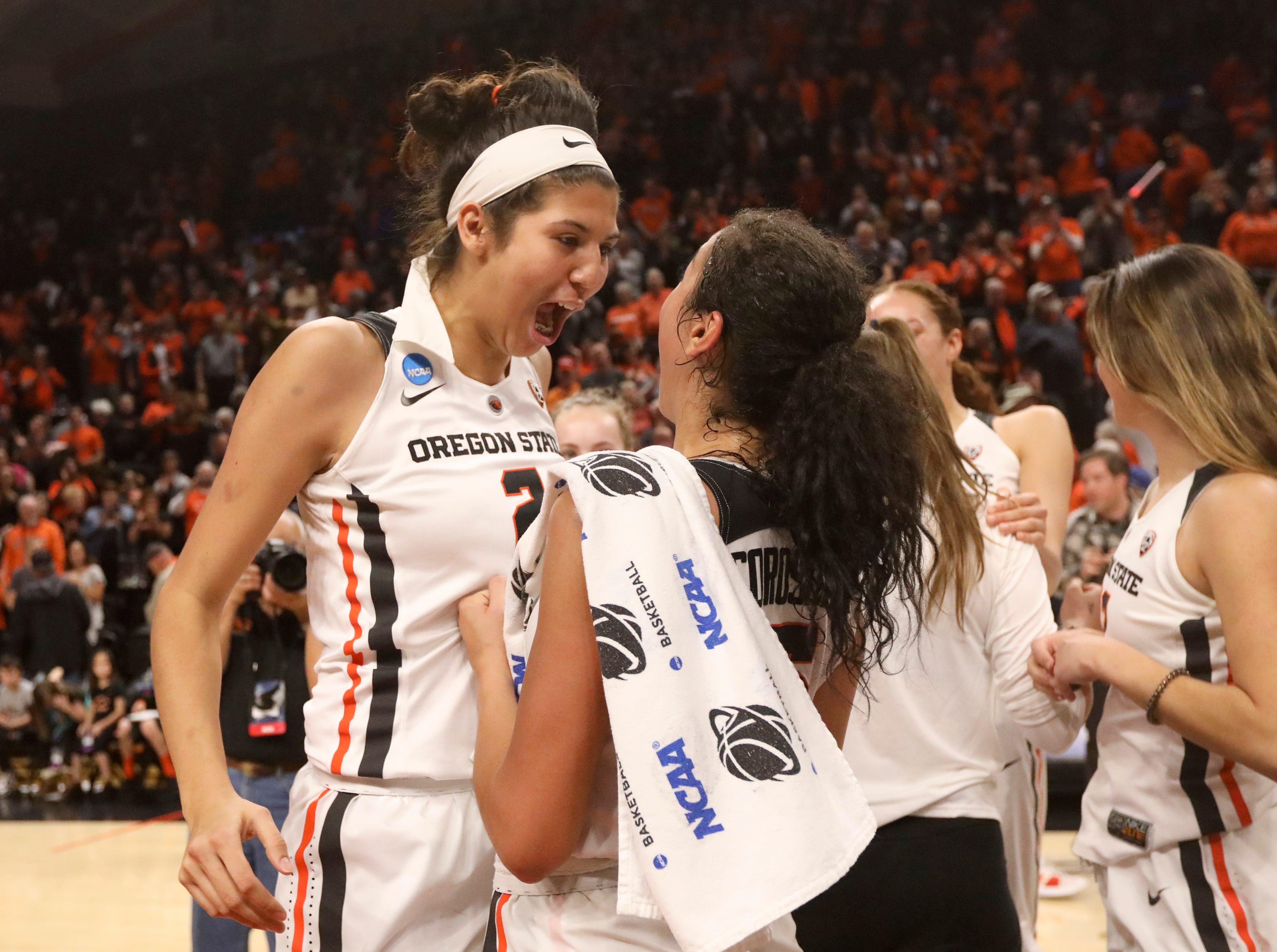 Oregon State's Andrea Aquino (2) and Taya Corosdale celebrate the team's 76-70 victory over Gonzaga in a second-round game of the NCAA women's college basketball tournament in Corvallis, Ore., Monday, March 25, 2019. (AP Photo/Amanda Loman)