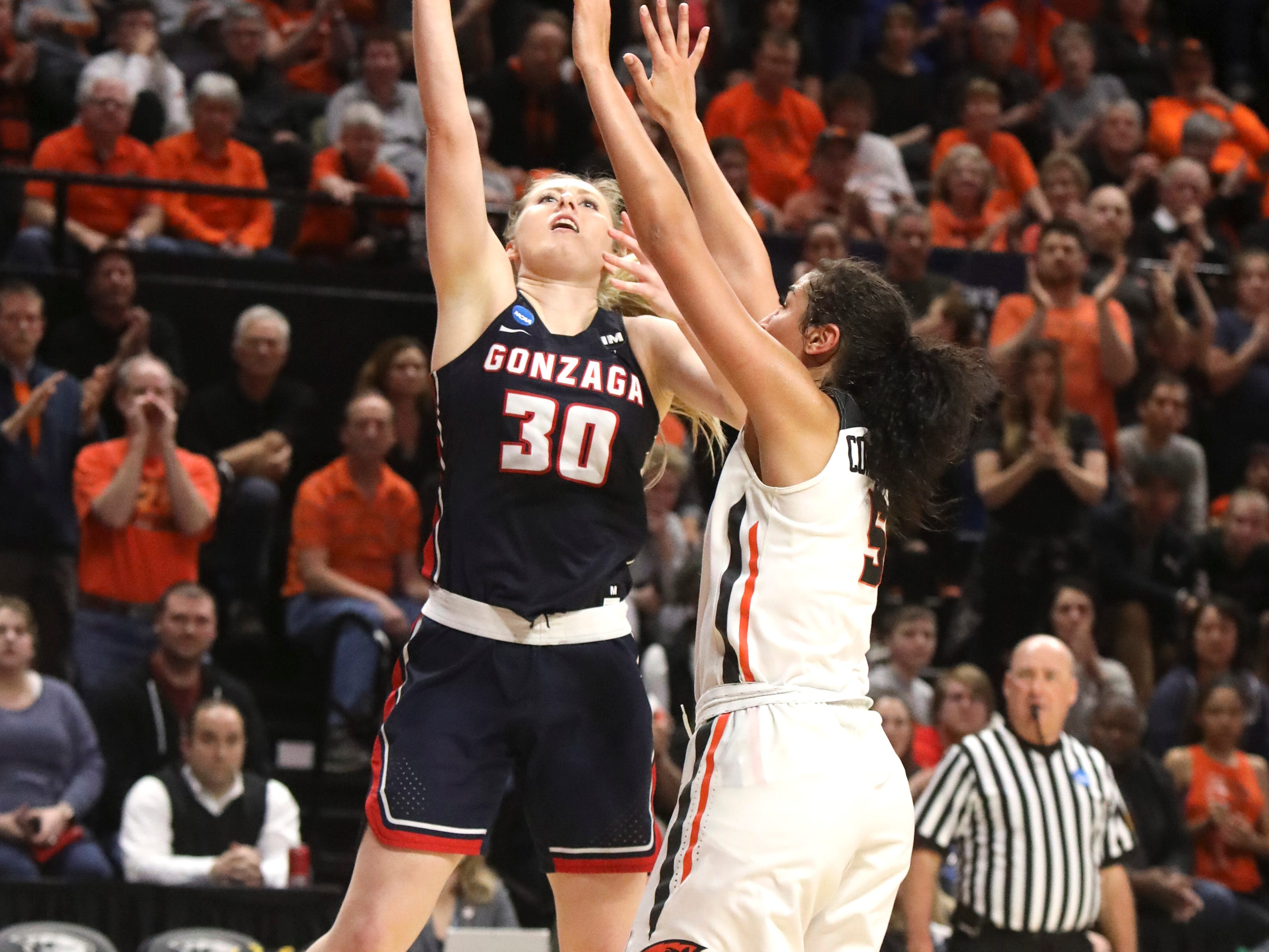 Oregon State's Taya Corosdale (5) tries to block a shot by Gonzaga's Chandler Smith (30) during the second half of a second-round game of the NCAA women's college basketball tournament in Corvallis, Ore., Monday, March 25, 2019. Oregon State won 76-70 (AP Photo/Amanda Loman)