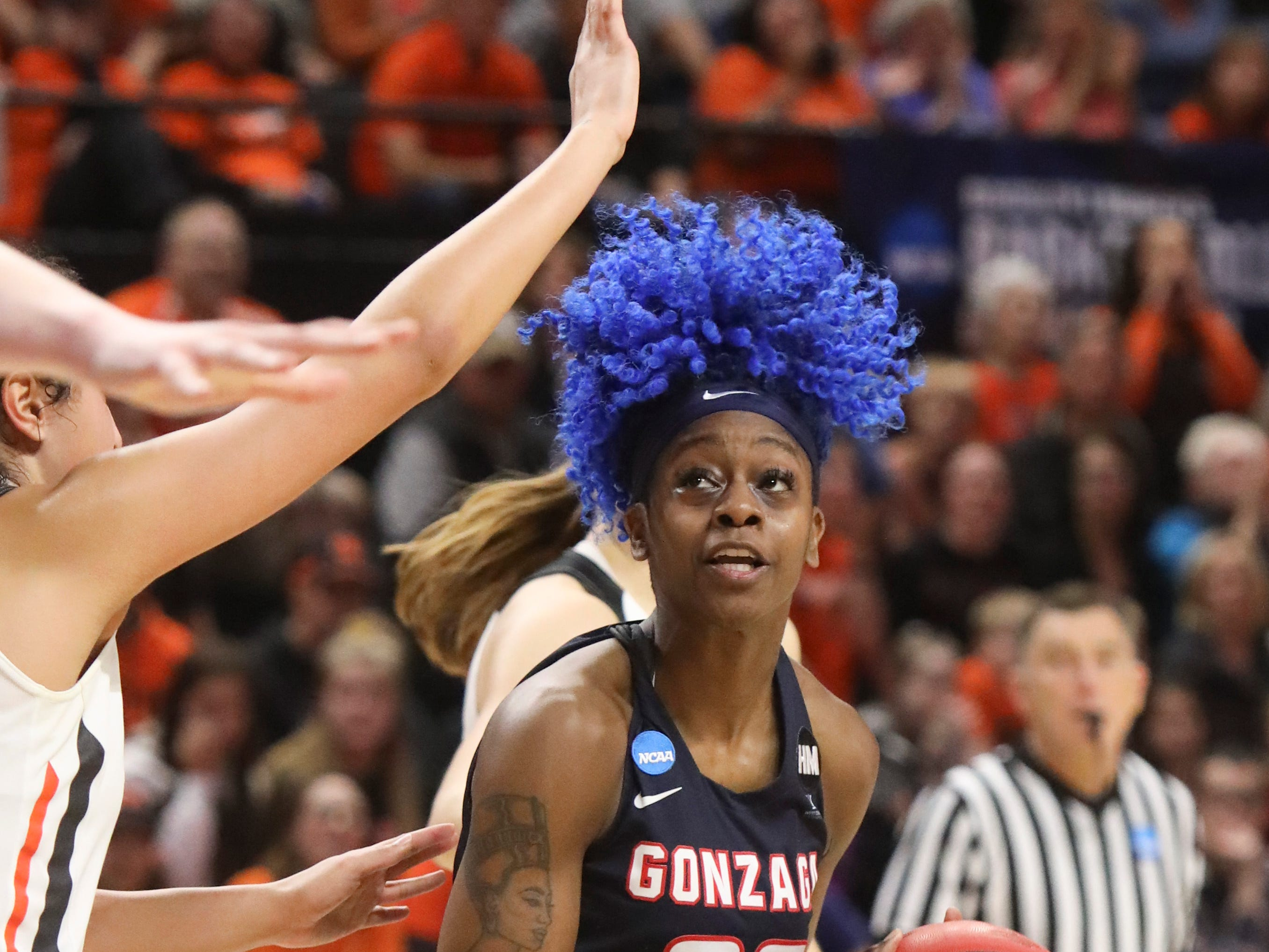 Gonzaga's Zykera Rice (00) looks for a path to the basket past Oregon State's Taya Corosdale (5) during the second half of a second-round game of the NCAA women's college basketball tournament against Oregon State in Corvallis, Ore., Monday, March 25, 2019. Oregon State won 76-70. (AP Photo/Amanda Loman)