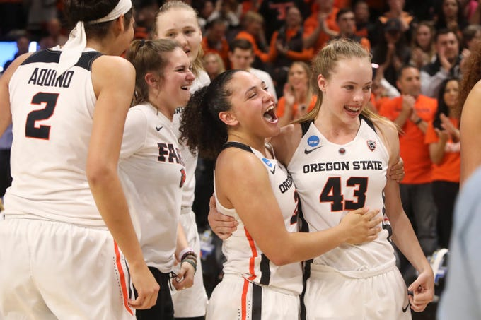 Oregon State's Andrea Aquino, Kat Tudor, Joanna Grymek, Destiny Slocum and Jasmine Simmons, from left, celebrate the team's 76-70 win over Gonzaga in a second-round game of the NCAA women's college basketball tournament in Corvallis, Ore., Monday, March 25, 2019. (AP Photo/Amanda Loman)