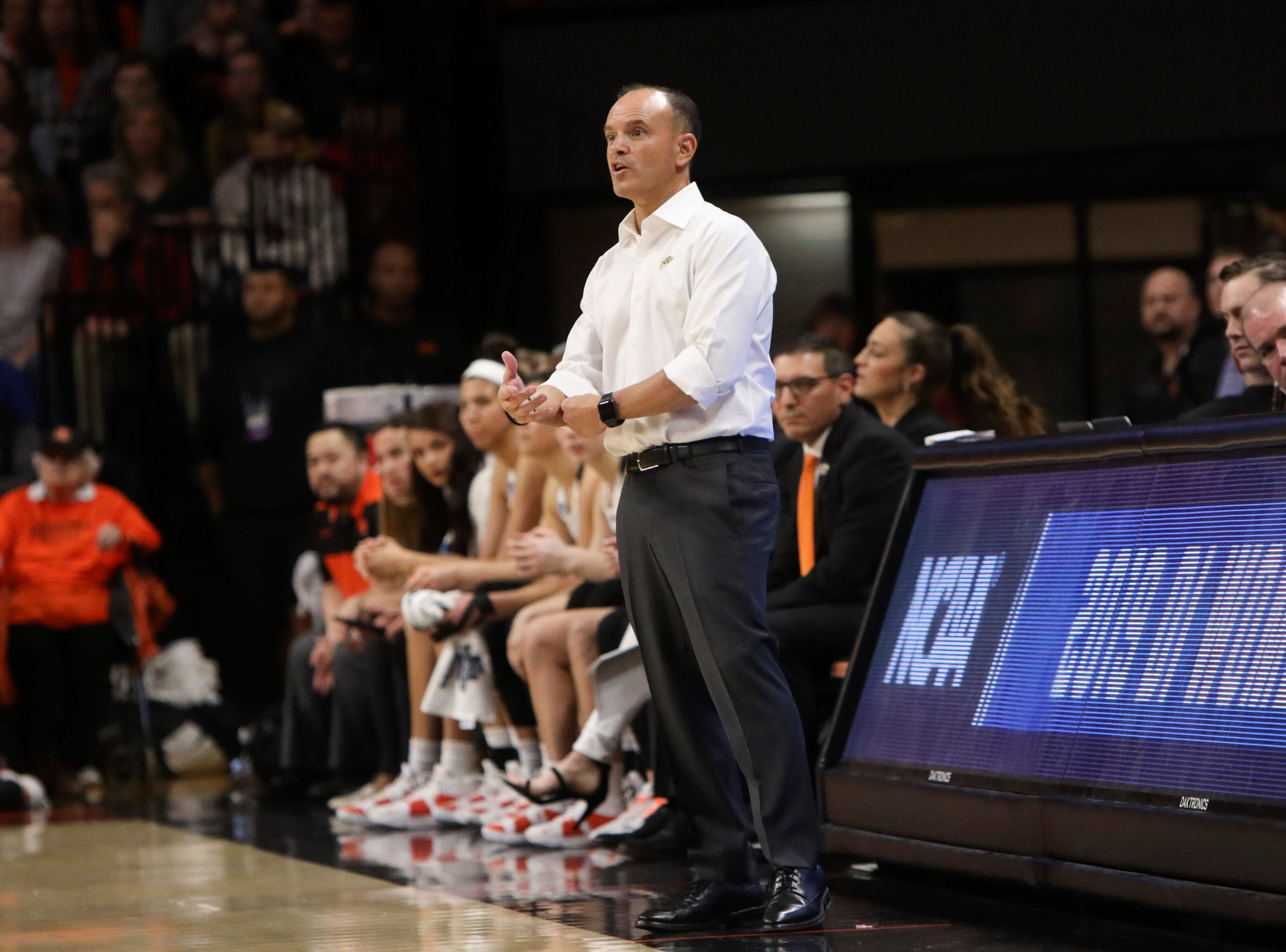 Oregon State head coach Scott Rueck calls out to players during the first half of a second-round game of the NCAA women's college basketball tournament against Conzaga in Corvallis, Ore., Monday, March 25, 2019. Oregon State won 76-70 (AP Photo/Amanda Loman)