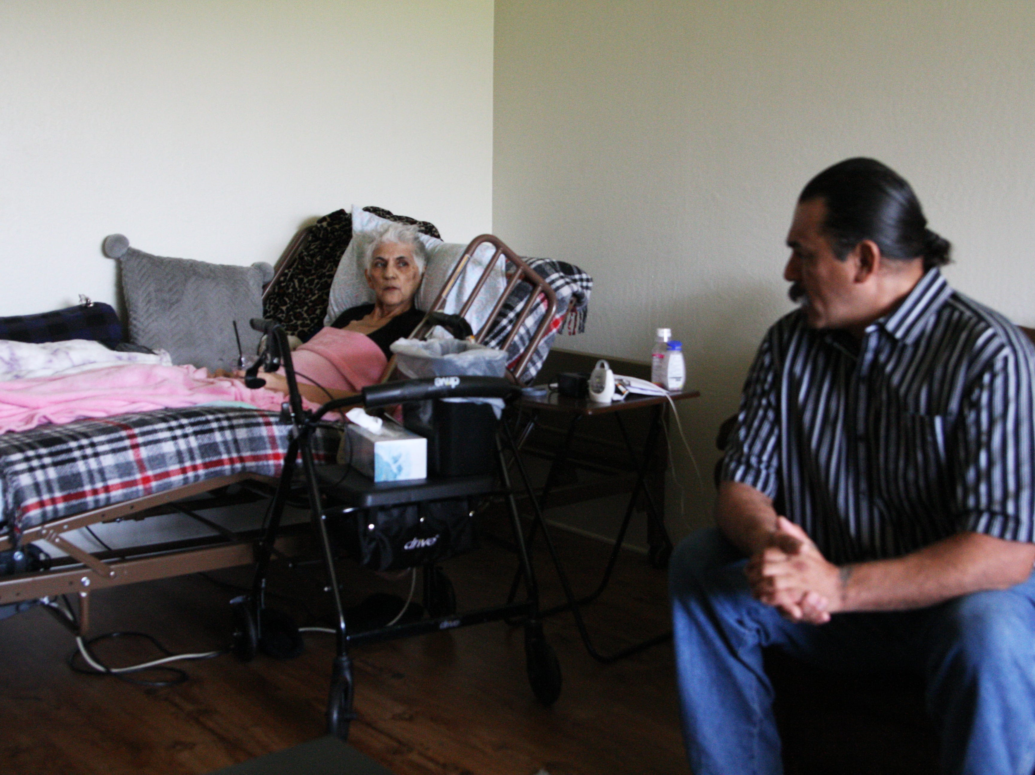 Gloria Torrez speaks with her son, Paul Jr. She is too weak to get out of bed now, and Paul Jr. must turn her every couple of hours.