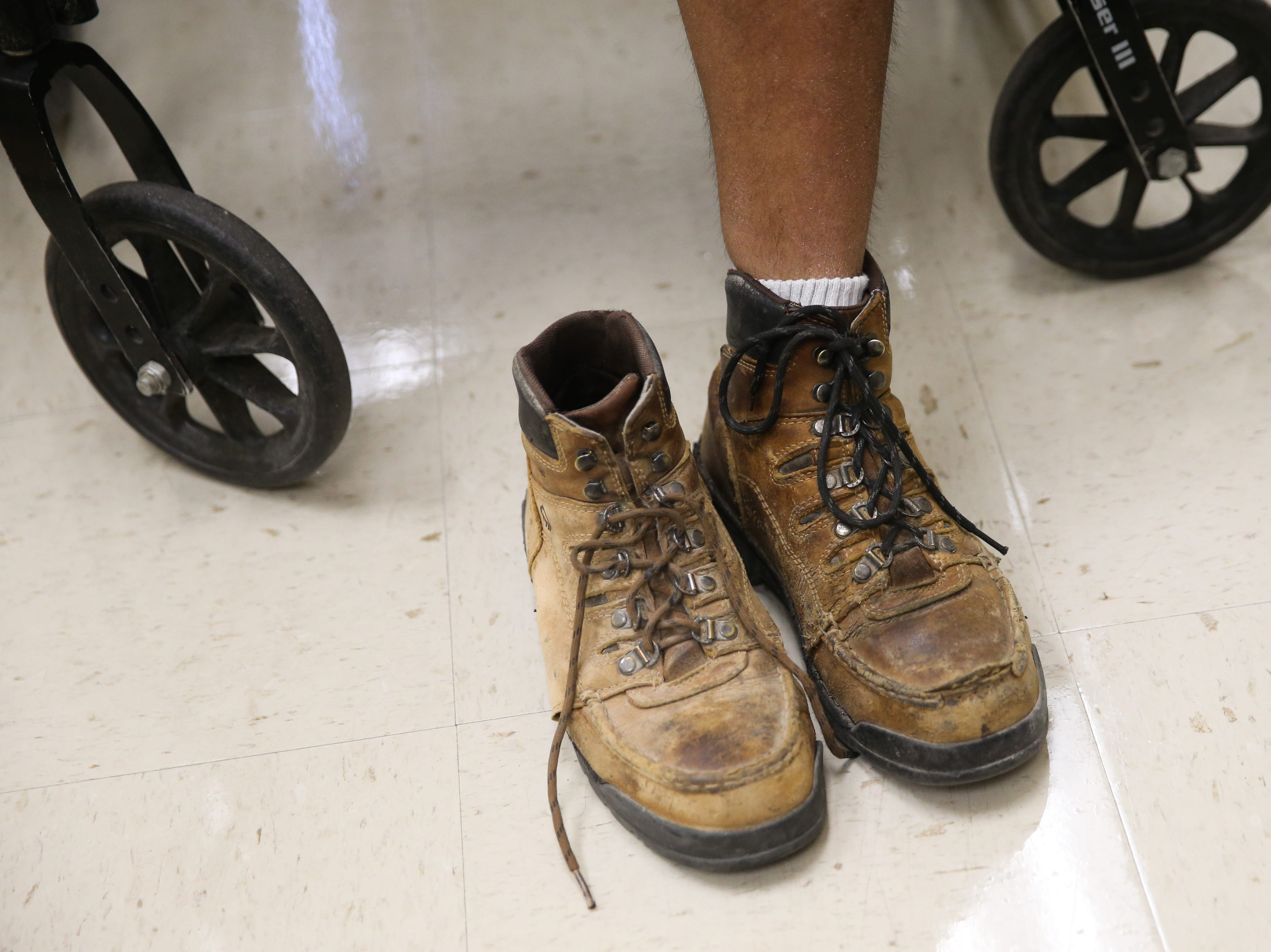 Jeremy Armenta waits for final adjustments on his new prosthetic Wednesday, March 20, 2019, at West Texas Rehab.