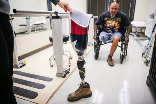 Jeremy Armenta sees his new prosthetic for the first time Wednesday, March 20, 2019, at West Texas Rehab.