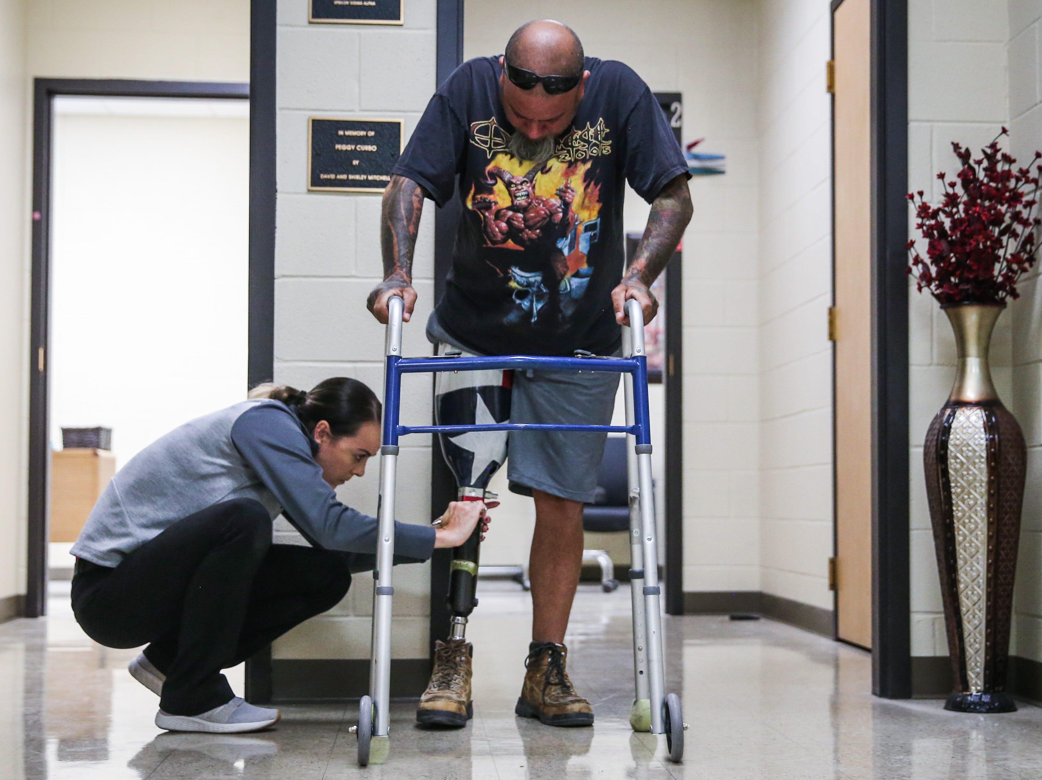 Whitney Brandon adjusts Jeremy Armenta's new prosthetic Wednesday, March 20, 2019, at West Texas Rehab.