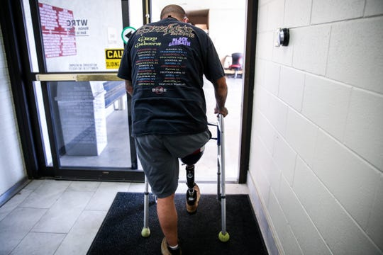 Jeremy Armenta walks out on his new prosthetic Wednesday, March 20, 2019, at West Texas Rehab.