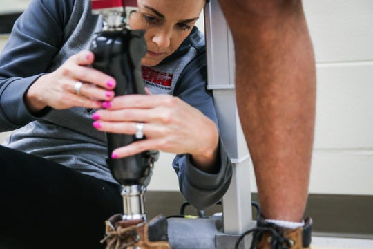 Whitney Brandon adjusts Jeremy Armenta's new prosthetic Wednesday, March 20, 2019, at West Texas Rehab.