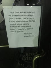 A sign on the door of Planet Fitness, 3552 Knickerbocker Road, explains a power outage Tuesday, March 26, 2019.