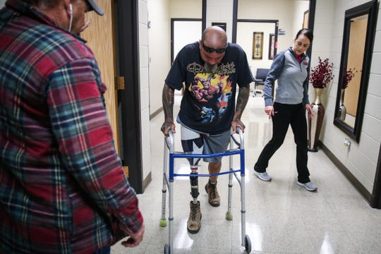 Jeremy Armenta walks on his new prosthetic Wednesday, March 20, 2019, at West Texas Rehab.
