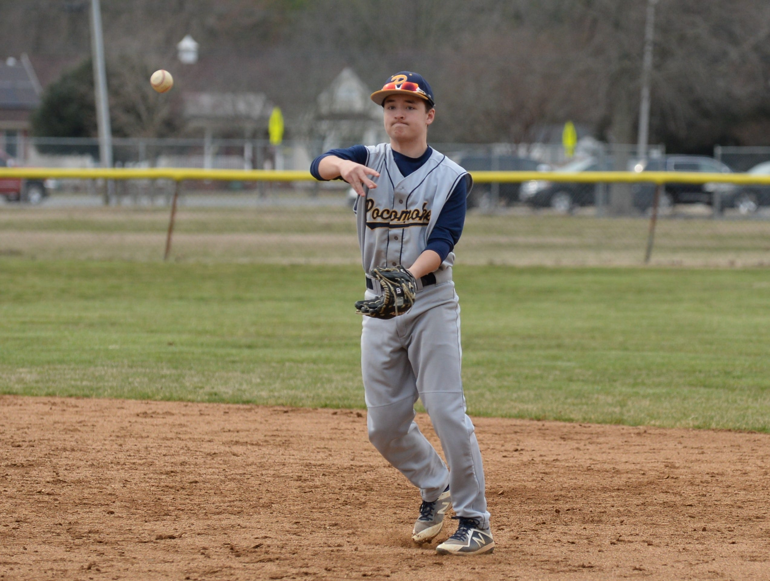 Pocomoke's second baseman makes a throw to first against Mardela on Monday, March 25, 2019.