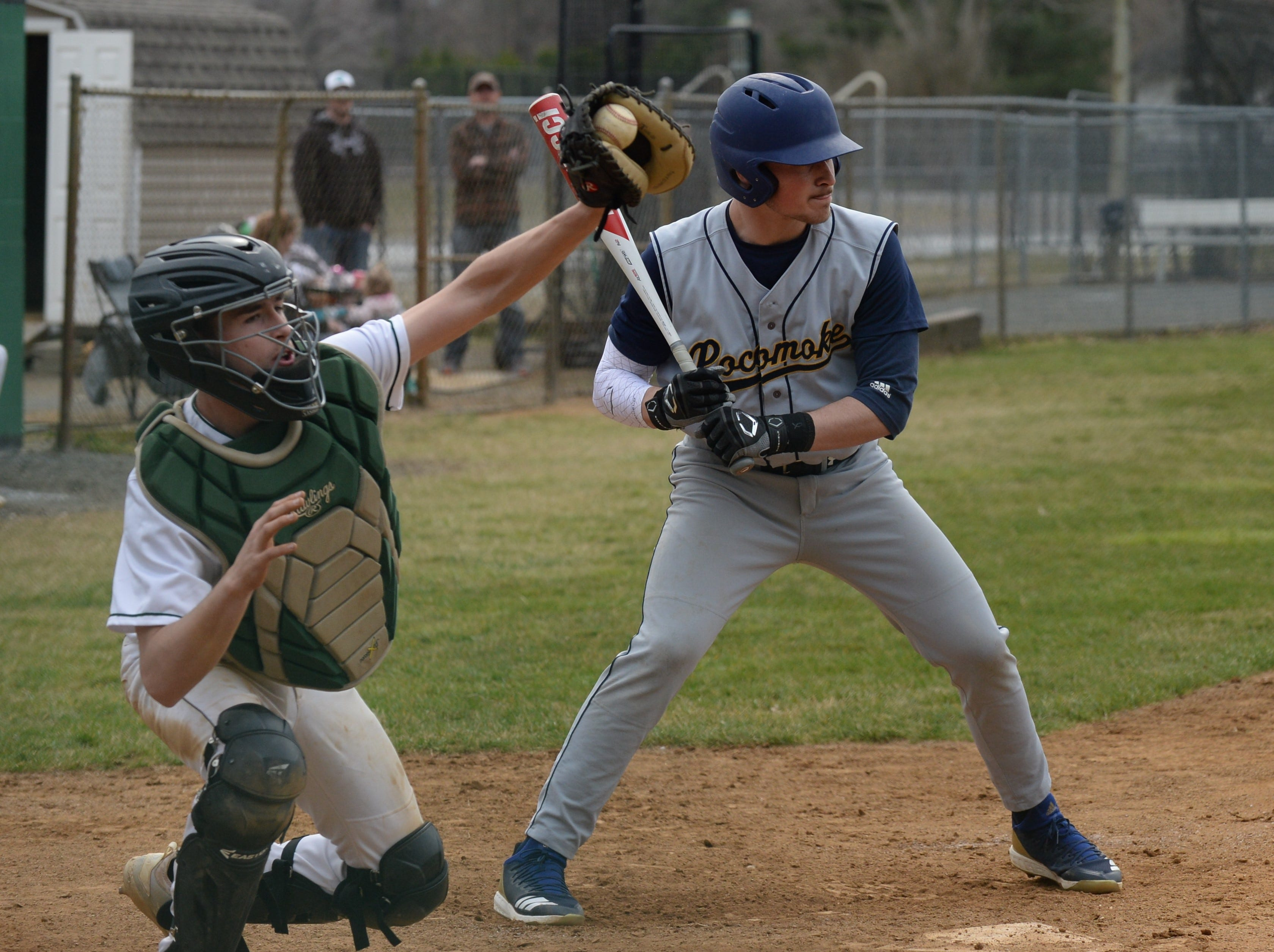 Mardela catcher Colton Lanham catches a high pitch as Pocomoke's Ethan Peterson mans the plate on Monday, March 25, 2019.