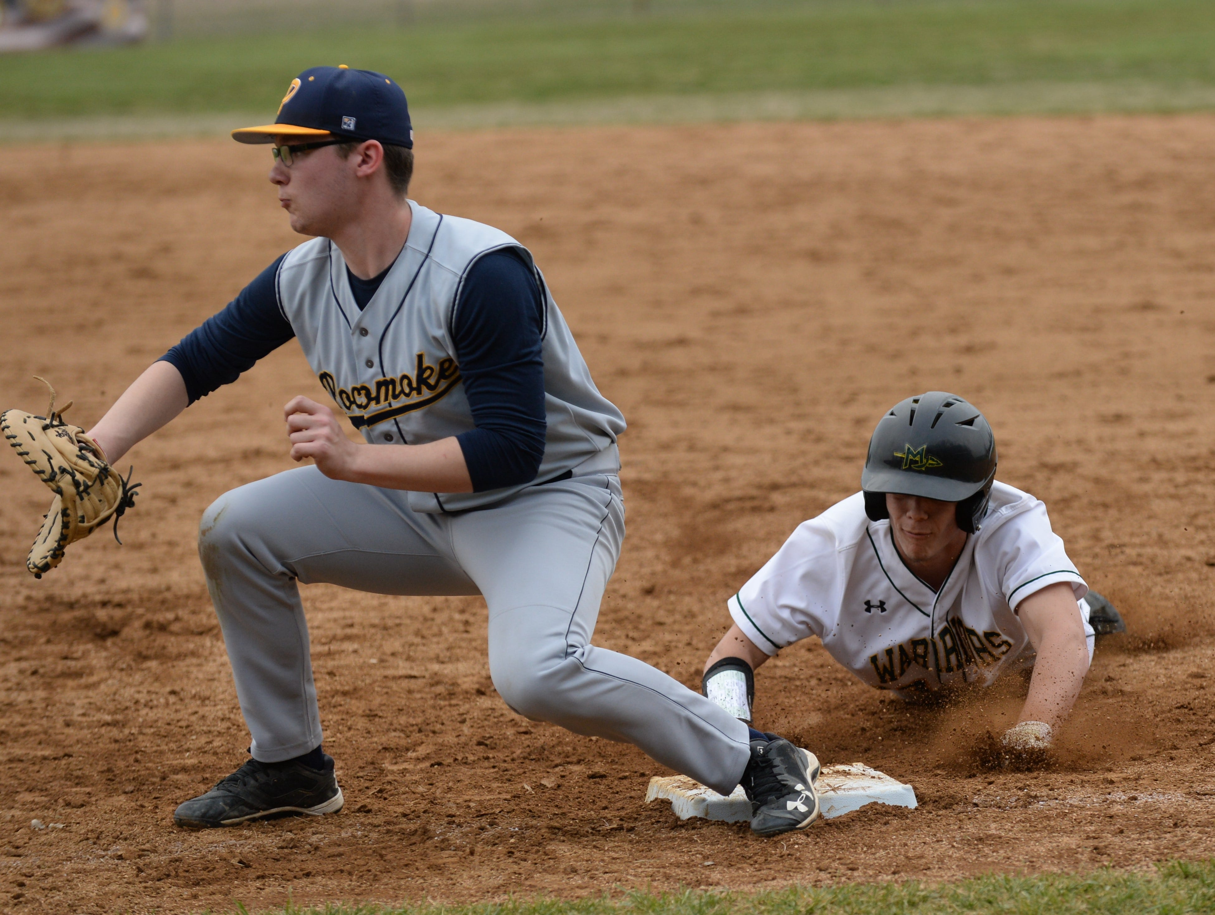 A Mardela player slides into first base after trying to steal against Pocomoke on Monday, March 25, 2019.