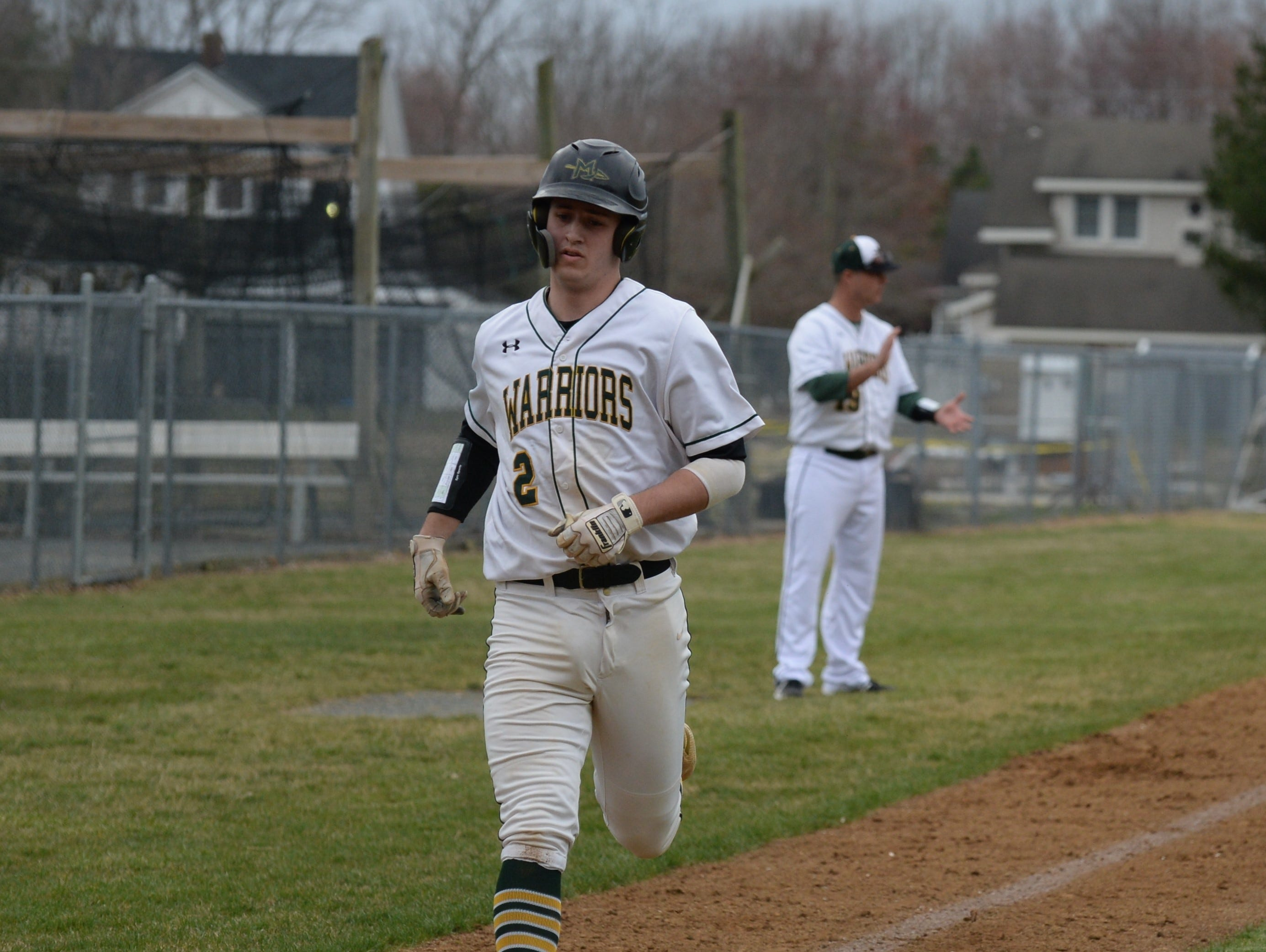 Mardela's Dylan Smith scores a run against Pocomoke on Monday, March 25, 2019.