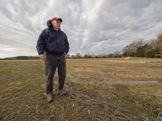 """This is how it starts."" Somerset County farmer Bob Fitzgerald looks over what started as a ""little wet spot"" that has swollen in just the last few years into a bowl-shaped, 2-acre void."