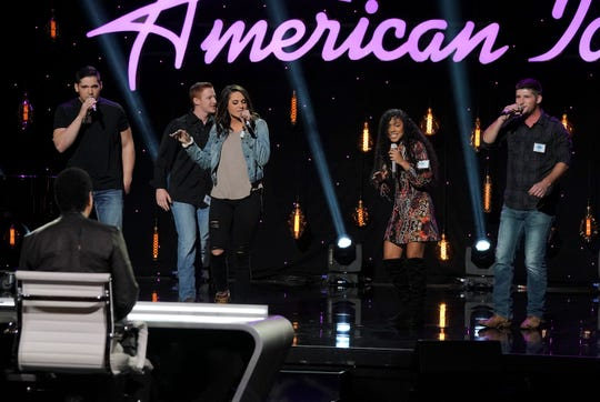 """Tyler Mitchell, of Louisiana, performs with his group during Hollywood Week on """"American Idol."""""""