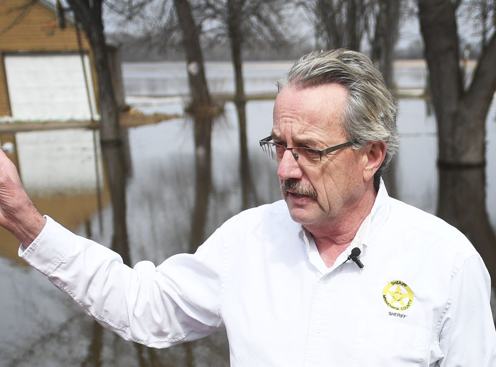 Minnehaha County Sheriff Mike Milstead talks to media about the water rescue that took place in Renner Tuesday, March 26, in Renner, S.D. Two adults, two children, three dogs and three cats were rescued by boat near Ditch Road and Mapleton Road.