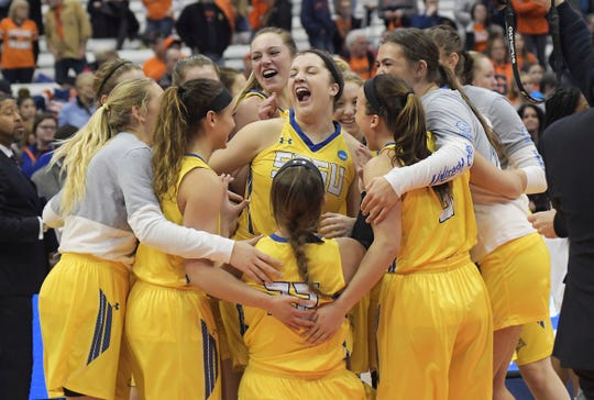South Dakota State players celebrate a 75-64 victory over Syracuse in a second-round game of the NCAA women's college basketball tournament in Syracuse, N.Y., Monday, March 25, 2019. At center is Paiton Burckhard.