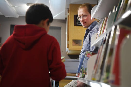 Siouxland Library associate Pete Hanson hosts an after school program for kids at Summit Heights Wednesday, March 20, in Sioux Falls. Siouxland Libraries is doing outreach activities to help unsupervised children after school.