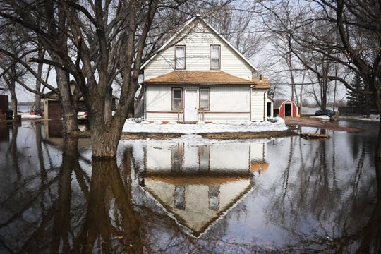 Flooding continues in Renner Tuesday, March 26, in Renner, S.D. The latest river forecasts have the Big Sioux at Dell Rapids staying at 'major' flood level until early next week.