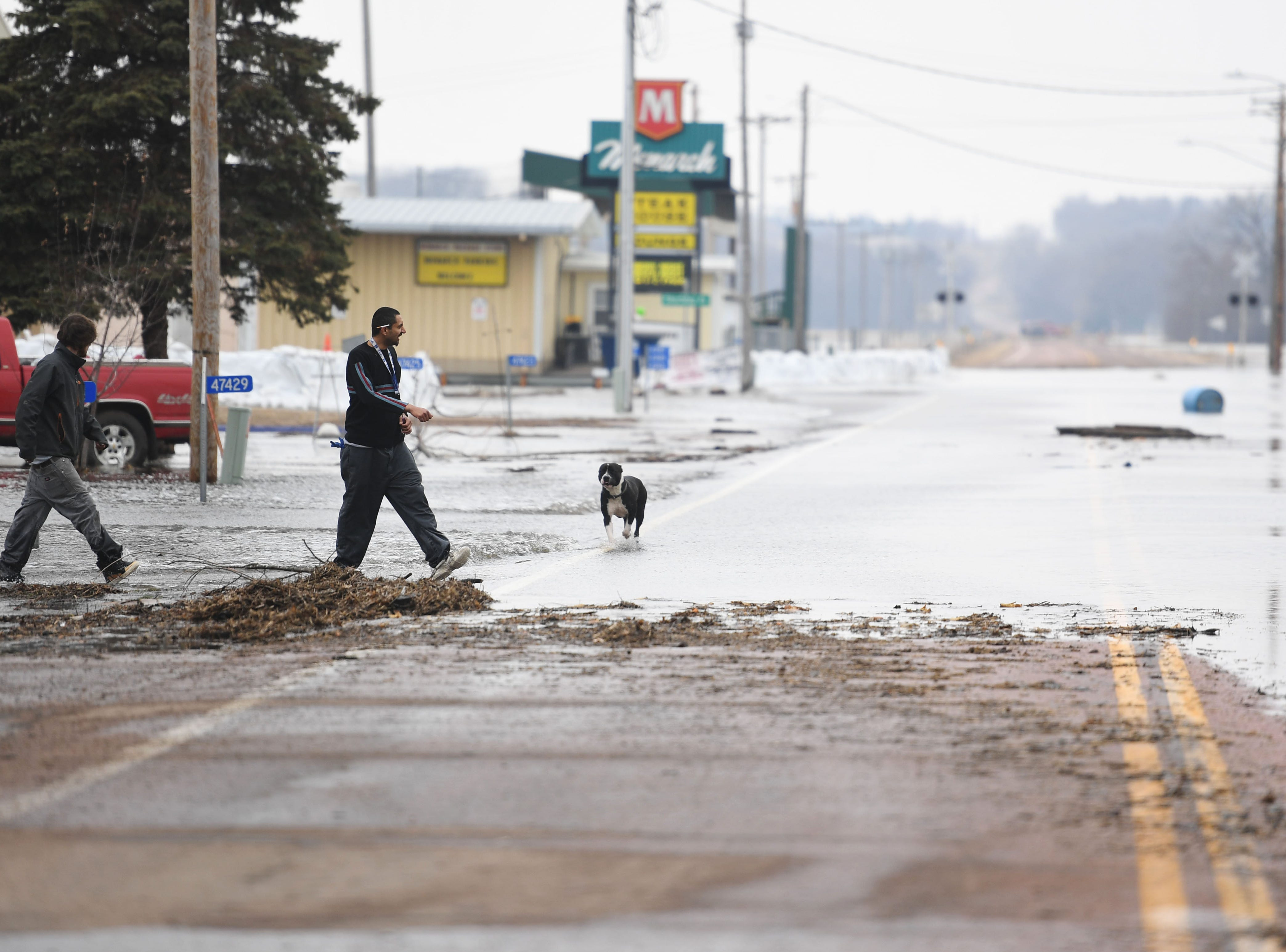 People leave their home on 258th street as flooding continues in Renner Tuesday, March 26, in Renner, S.D. The latest river forecasts have the Big Sioux at Dell Rapids staying at 'major' flood level until early next week.