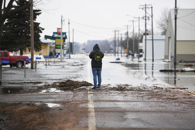 Dustin Griffin takes photos of flooded streets in Renner Tuesday, March 26, in Renner, S.D. The latest river forecasts have the Big Sioux at Dell Rapids staying at 'major' flood level until early next week.