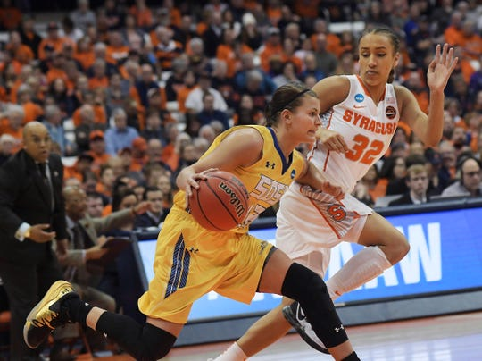 South Dakota State's Macy Miller (12) dribbles past Syracuse's Miranda Drummond (32) during the second half of a second-round game of the NCAA women's college basketball tournament in Syracuse, N.Y., Monday, March 25, 2019. South Dakota State won 75-64. (AP Photo/Heather Ainsworth)