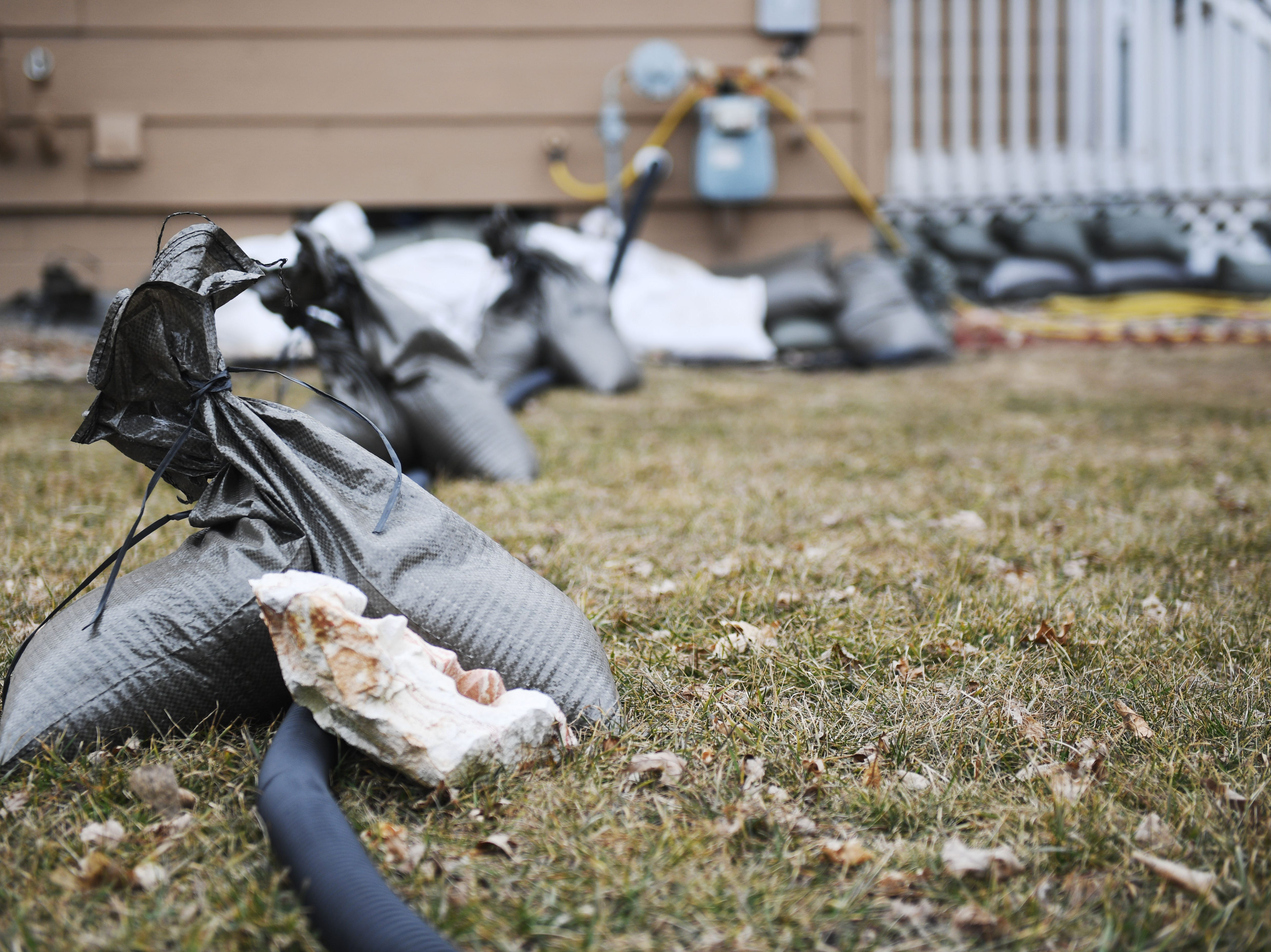 Homes on South Kiwanis Avenue are set up for flood prevention near Tomar Park Tuesday, March 26, in Sioux Falls.