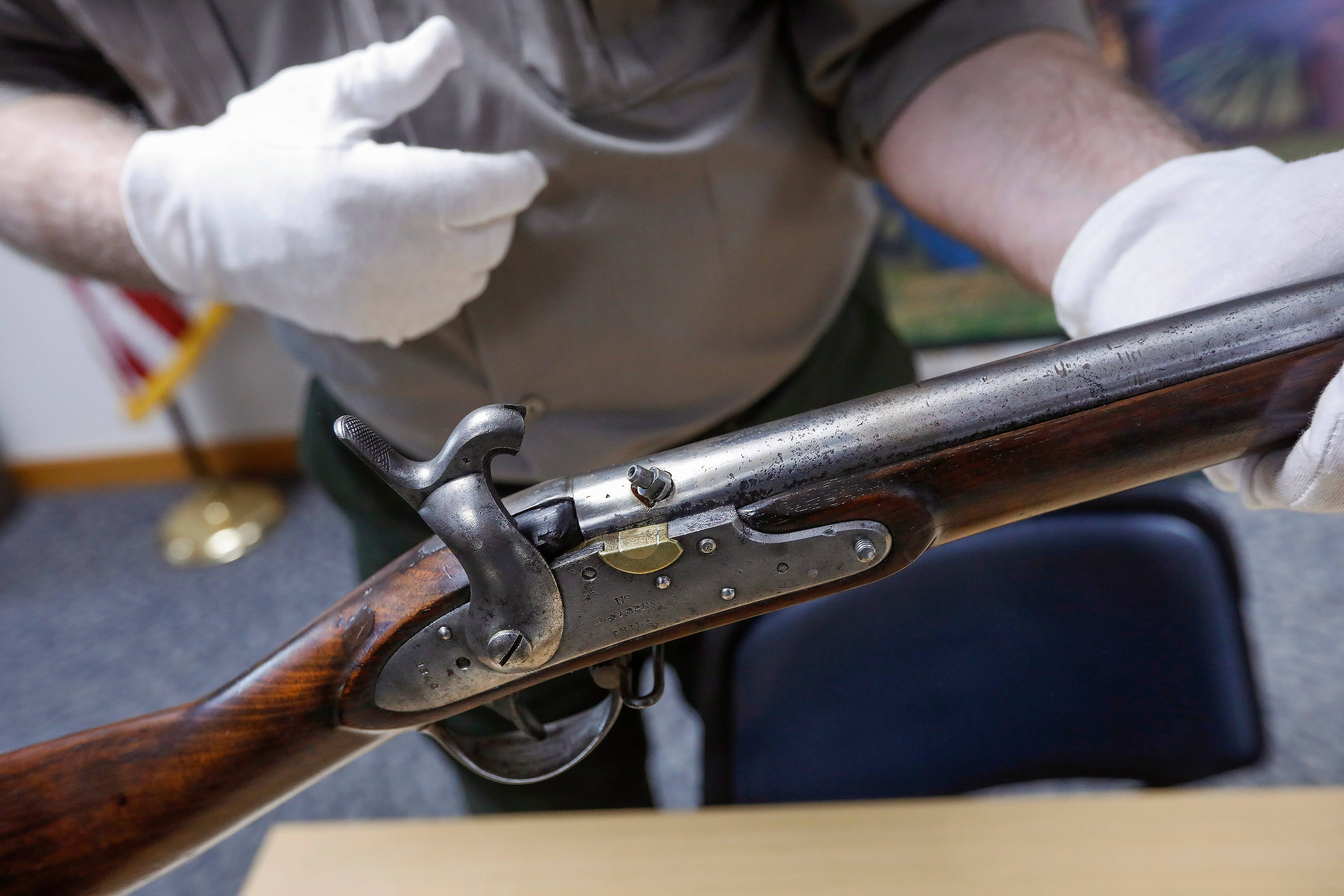 Jeff Patrick, the curator at Wilson's Creek National Battlefield, displays a Civil War era musket. The musket is one of the artifacts that will be on display after renovations to the visitors center are completed.