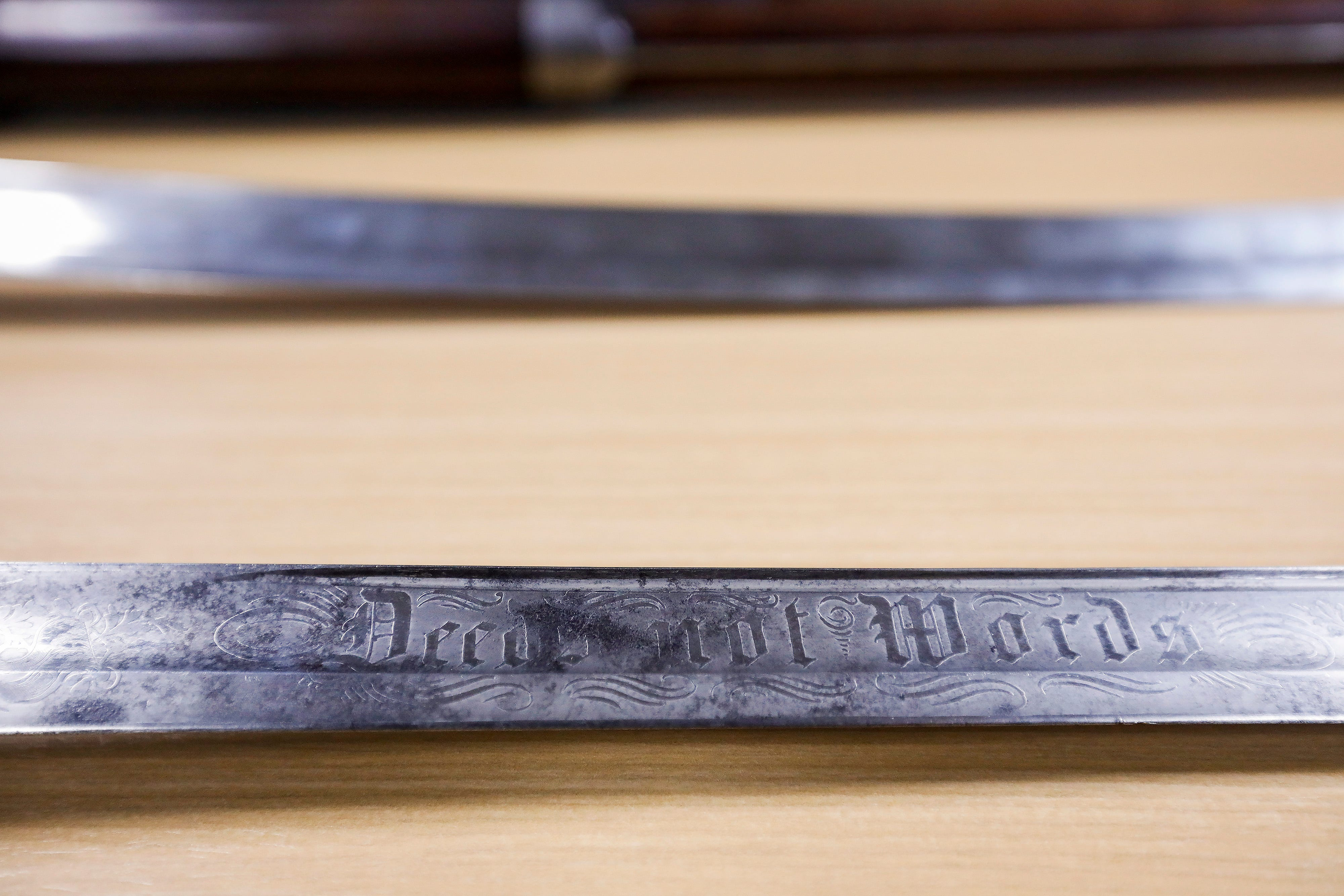 """The sword belonging to Civil War Captain J.F. Sanford is inscribed with """"Deeds not Words."""" The sword is one of the artifacts that will be on display after renovations are completed to the visitors center at Wilson's Creek National Battlefield."""