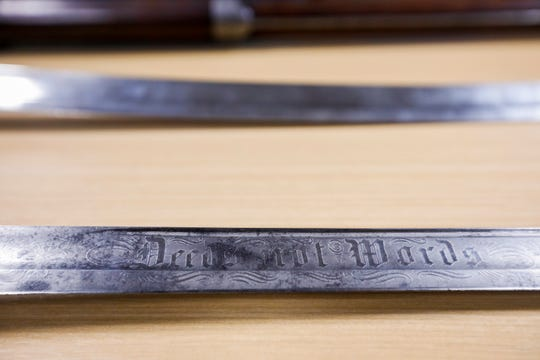 "The sword belonging to Civil War Captain J.F. Sanford is inscribed with ""Deeds not Words."" The sword is one of the artifacts that will be on display after renovations are completed to the visitors center at Wilson's Creek National Battlefield."