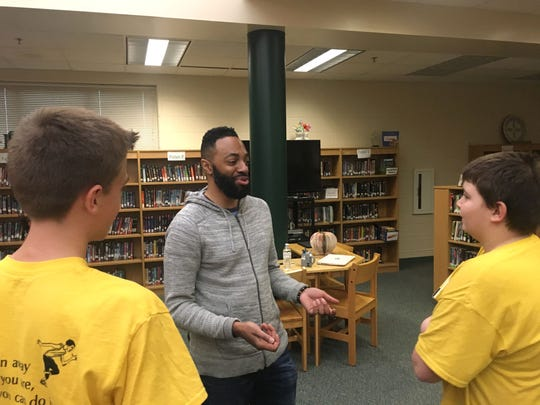 """Matthew Carter, the basis for the main character """"Ghost,"""" talks with Wilson Middle School students last week."""