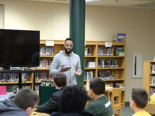 "Matthew Carter, the basis for the main character in the book ""Ghost,"" speaks to eighth-grade students at Wilson Middle School last week."