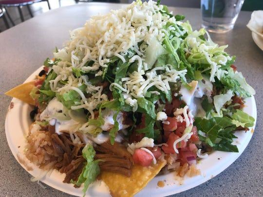 Lamy's Mexican Grill serves up pork nachos.