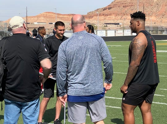 SUU's Marquez Tucker (far right) talks with NFL scouts after his pro day work out on March 26th.